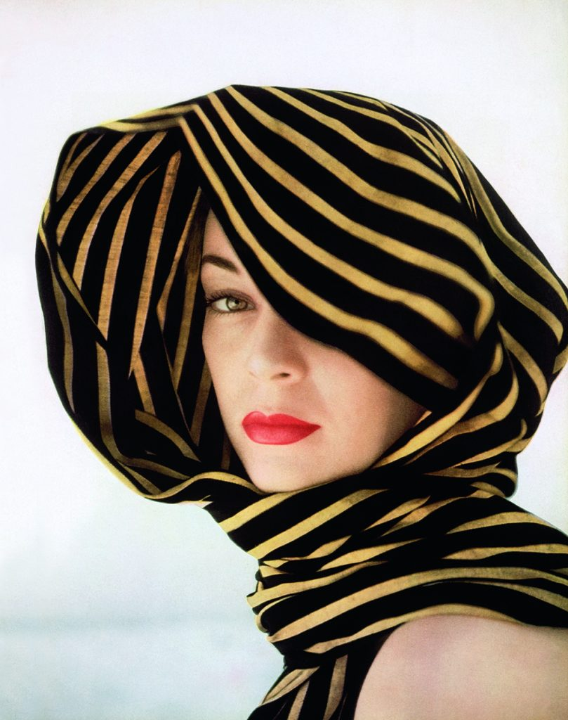 Vogue 100 Head of model, Jean Patchett, sheltered with a rebozo of black and gold stripes